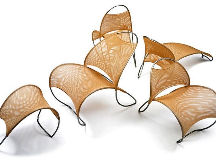WILLIAM PEDERSEN. La colección Loop de Loop cuenta con un chaise lounge, un sillón otomano y una silla para cenar (Jock Pottle Photography).